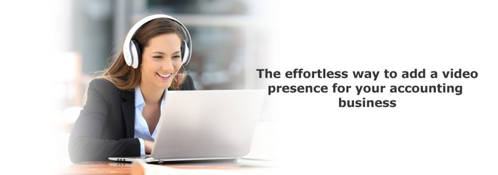 businesswoman wearing white headset lookin at laptop screen