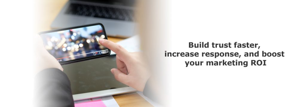 woman holding phone that is playing a blurred video - text on side that says build trust faster, increase response and boost your marketing ROI